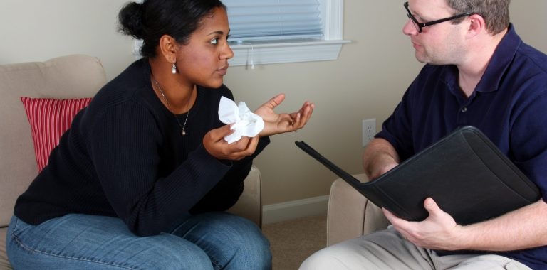 Woman receiving help from carer